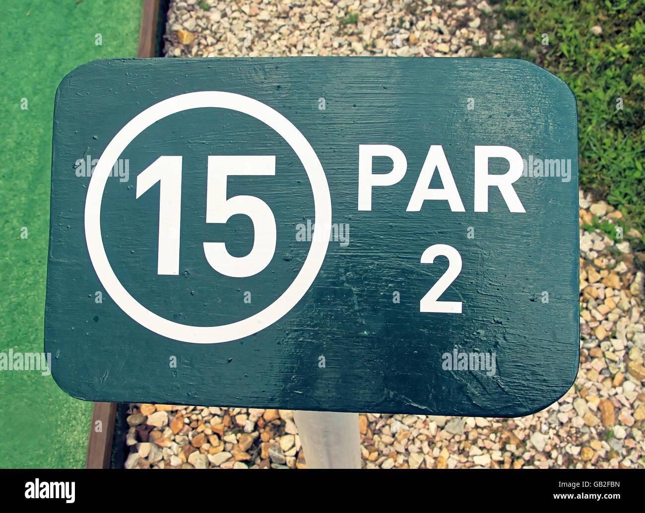 Mini golf course green sign Par 2 hole 15. - Stock Image