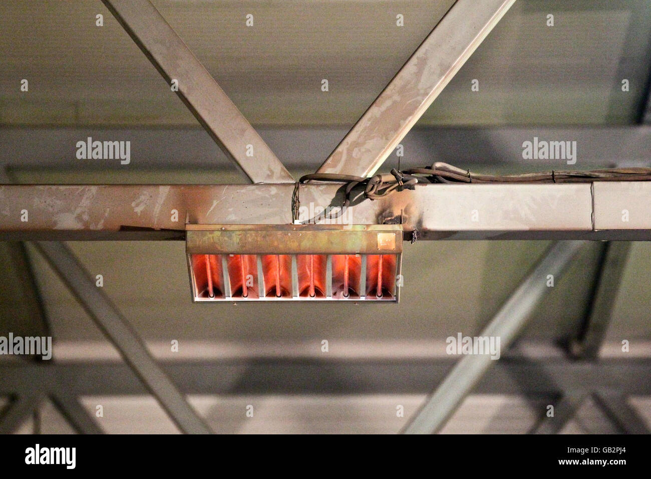fasteners sections of infrared heaters for heating industrial plant - Stock Image
