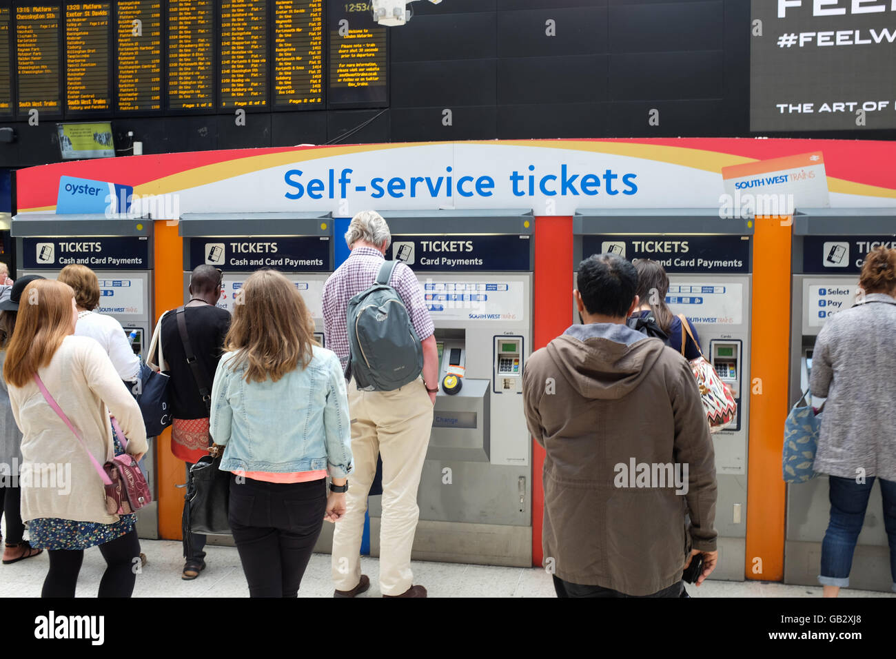 Self-service ticket machines at Waterloo station in London, England. - Stock Image