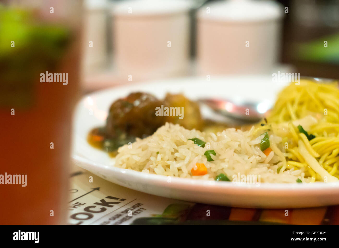 Delicious chinese food shot with a shallow depth of field. Showing oriental asian food with rice, noodles and meat - Stock Image
