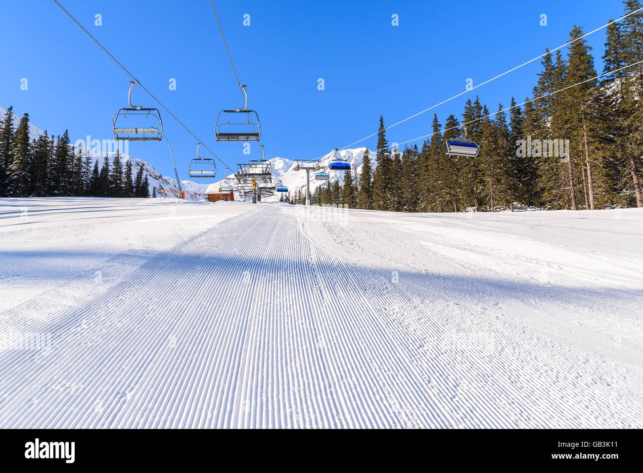 Freshly groomed ski slope in Rohace winter resort, Tatra Mountains, Slovakia Stock Photo