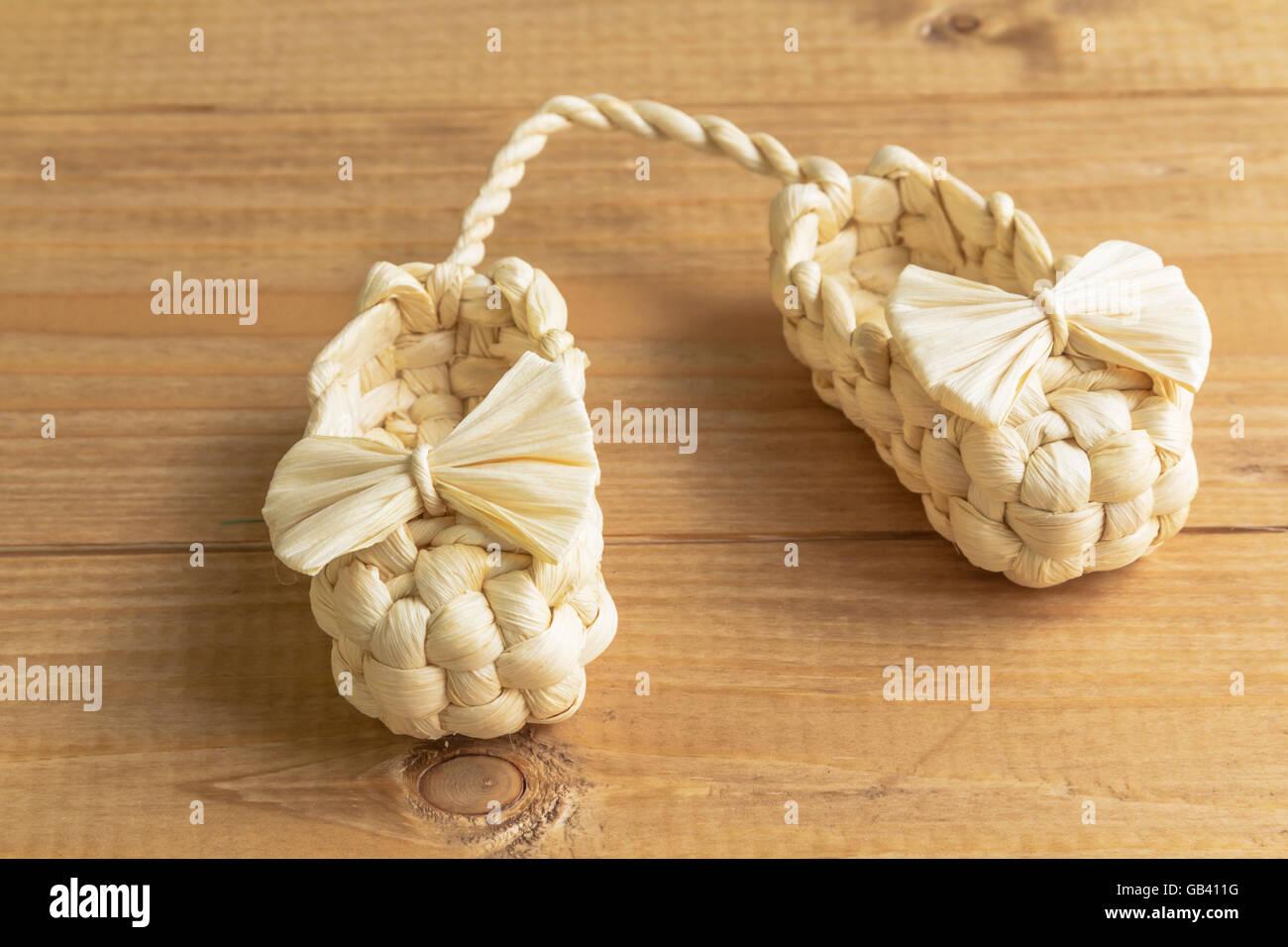 Bast shoes souvenir beige pair on the table - Stock Image