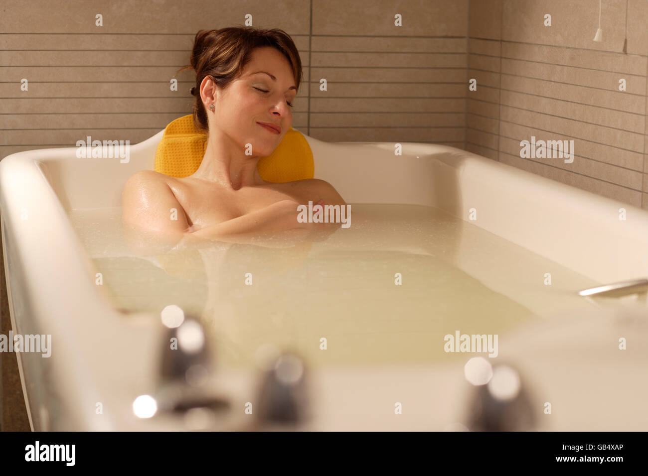 a4b970458d7 Woman, 35, relaxing in a bathtub, Aphrodite bath with whey, Thalasso ...