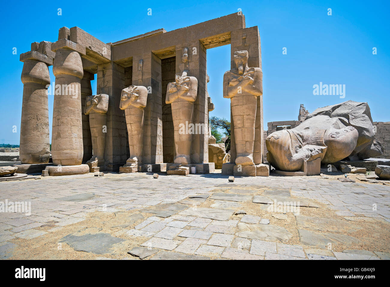 Osiris-pillars and the remains of a colossal statue of Ramses, Ramesseum Temple, Luxor, Egypt - Stock Image