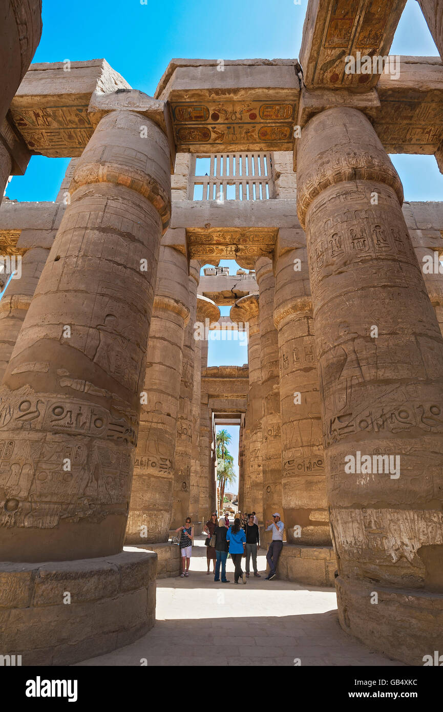 Portico with tourists in the Karnak Temple, Karnak, Luxor, Egypt - Stock Image