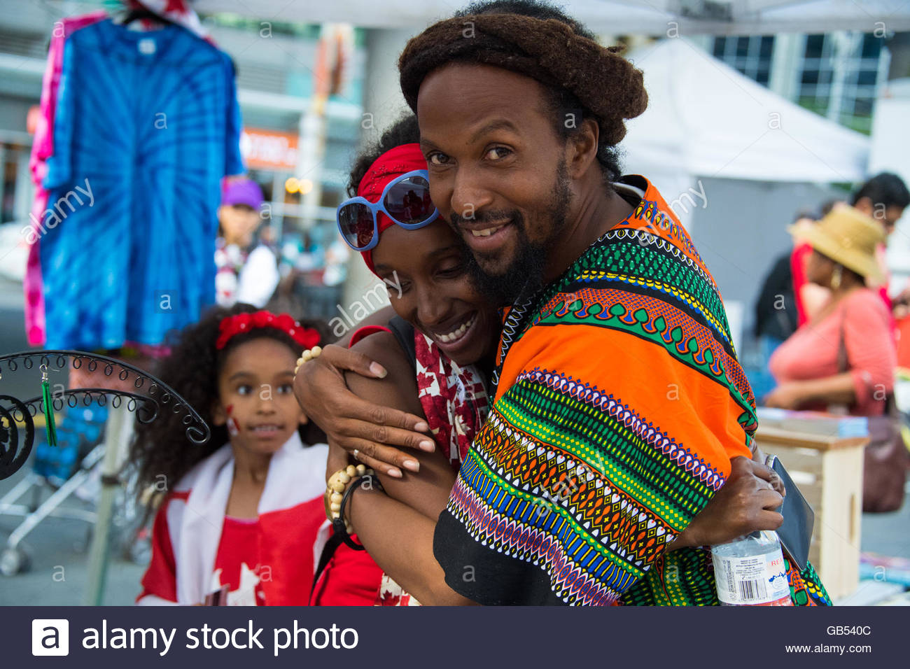 Canada Day people: Jamaican or Afro Caribbean people vendors in Dundas Square - Stock Image