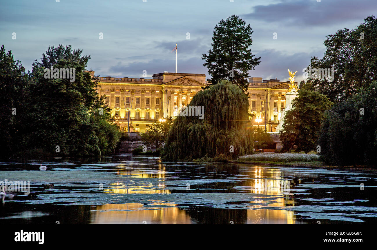 Buckingham Palace At night with Pond In St James Park London UK - Stock Image
