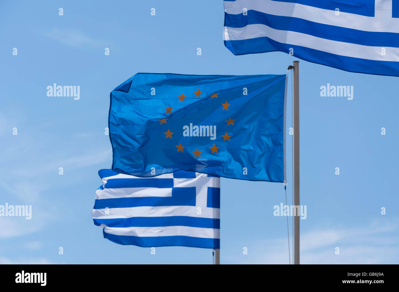 The European flag flying with Greek flags, Kefalos, Kos (Cos), The Dodecanese, South Aegean Region, Greece - Stock Image