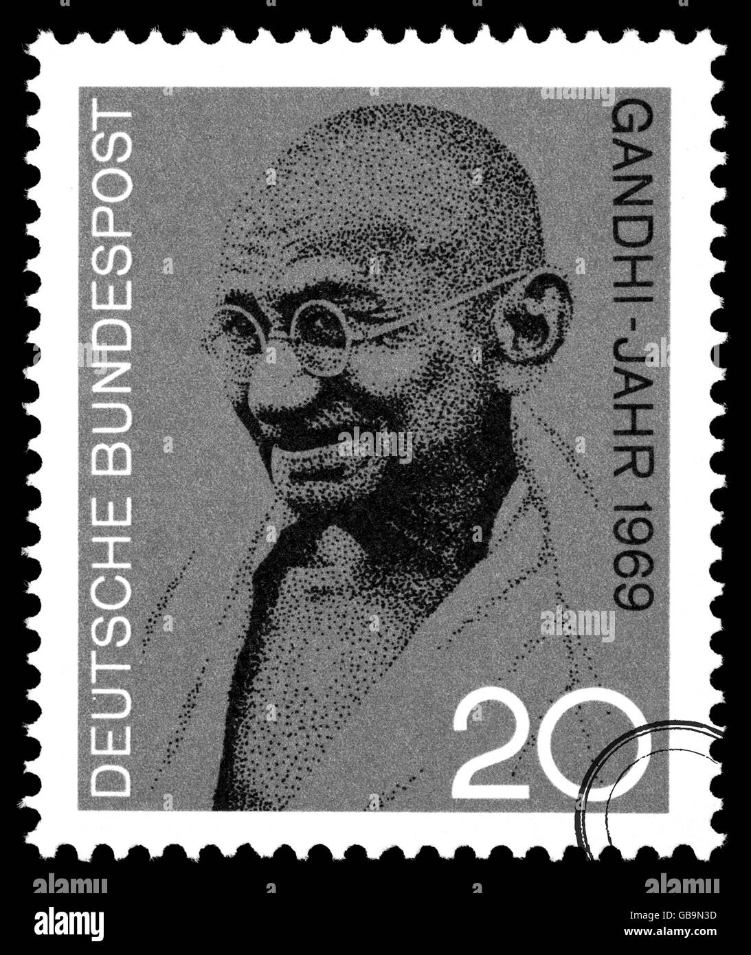 A postage stamp printed in Germany depicting a portrait of Mohandas Karamchand Gandhi, circa 2004 - Stock Image