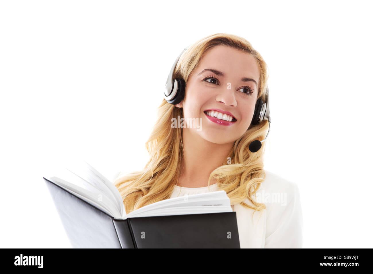 Closeup portrait of female customer service representative wearing headset. Stock Photo