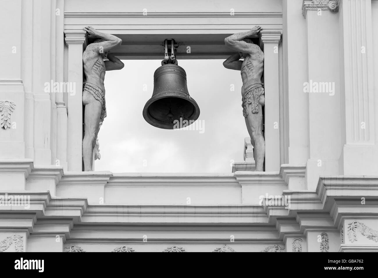 Statues supporting a bell column in the Cathedral of Leon, Nicaragua - Stock Image