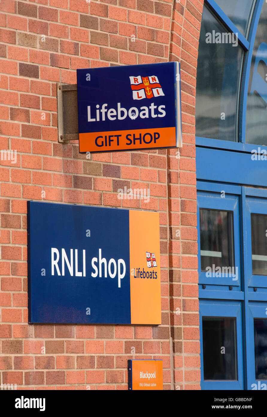 RNLI Lifeboats Shop sign outside the Lifeboat Station on the seafront in Blackpool, Lancashire, UK - Stock Image