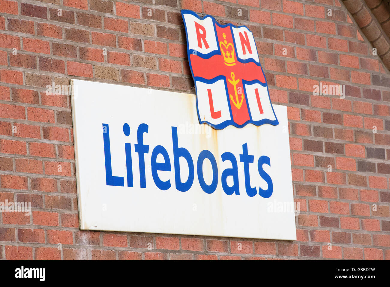 RNLI Lifeboats sign on the wall of the Lifeboat Station on the seafront in Blackpool, Lancashire, UK - Stock Image