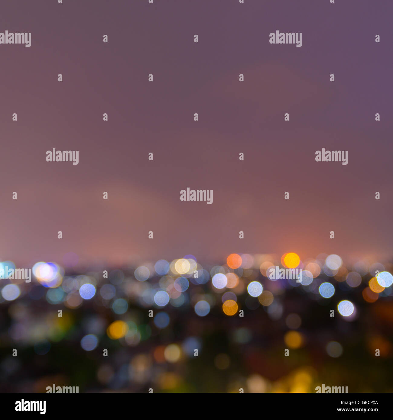 Out of focus city lights at night background Stock Photo