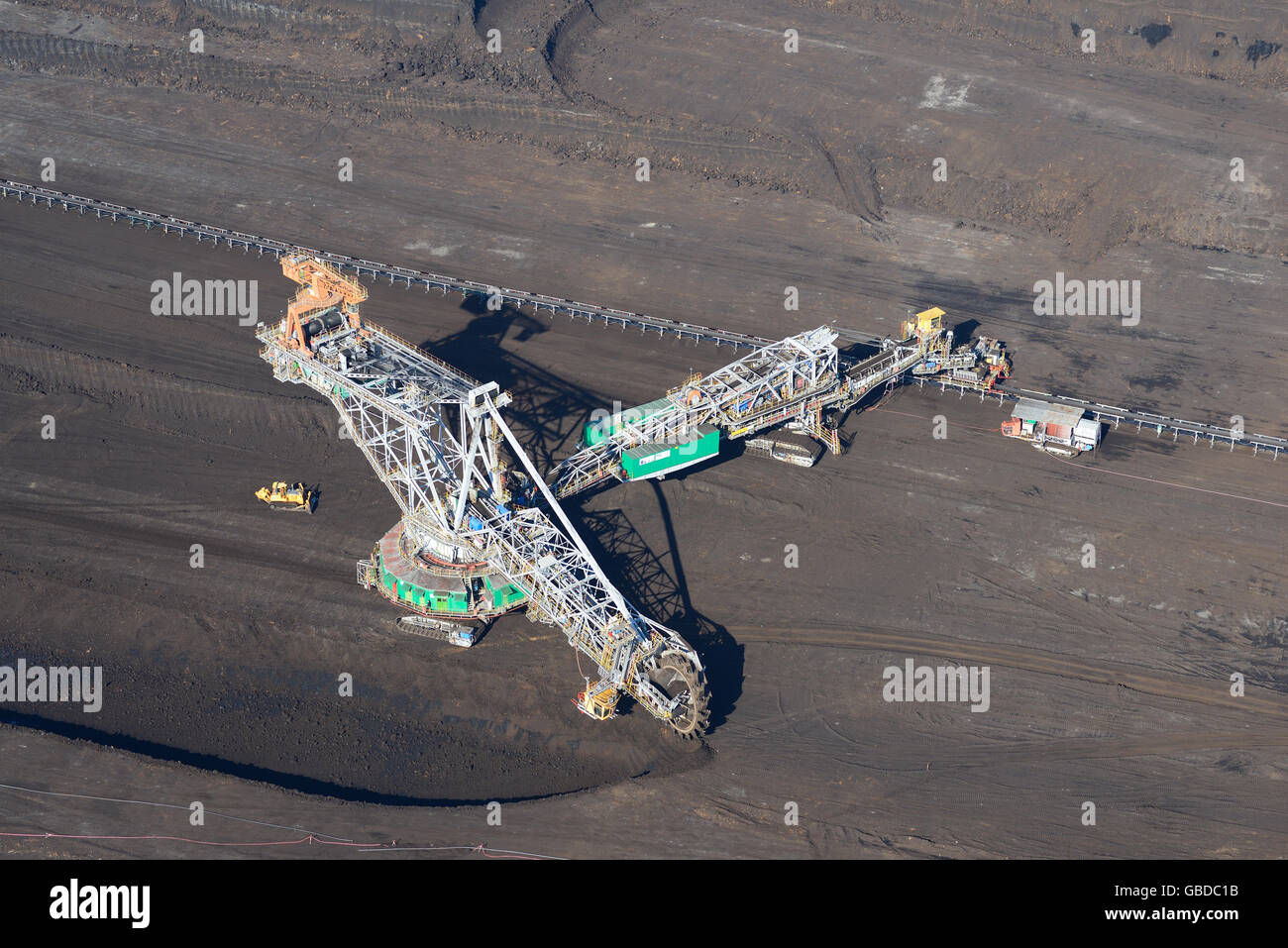 BUCKET-WHEEL EXCAVATOR IN AN OPEN-PIT COAL MINE (aerial view). Near Belchatow in Poland. - Stock Image