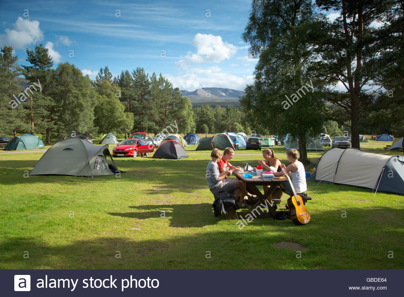 Enjoying a picnic at the campsite at Glenmore Forest Park near Aviemore, Highlands of Scotland. - Stock Image