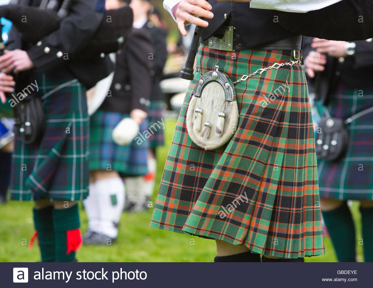 A detail of the kilts of a pipe band, Scotland. - Stock Image