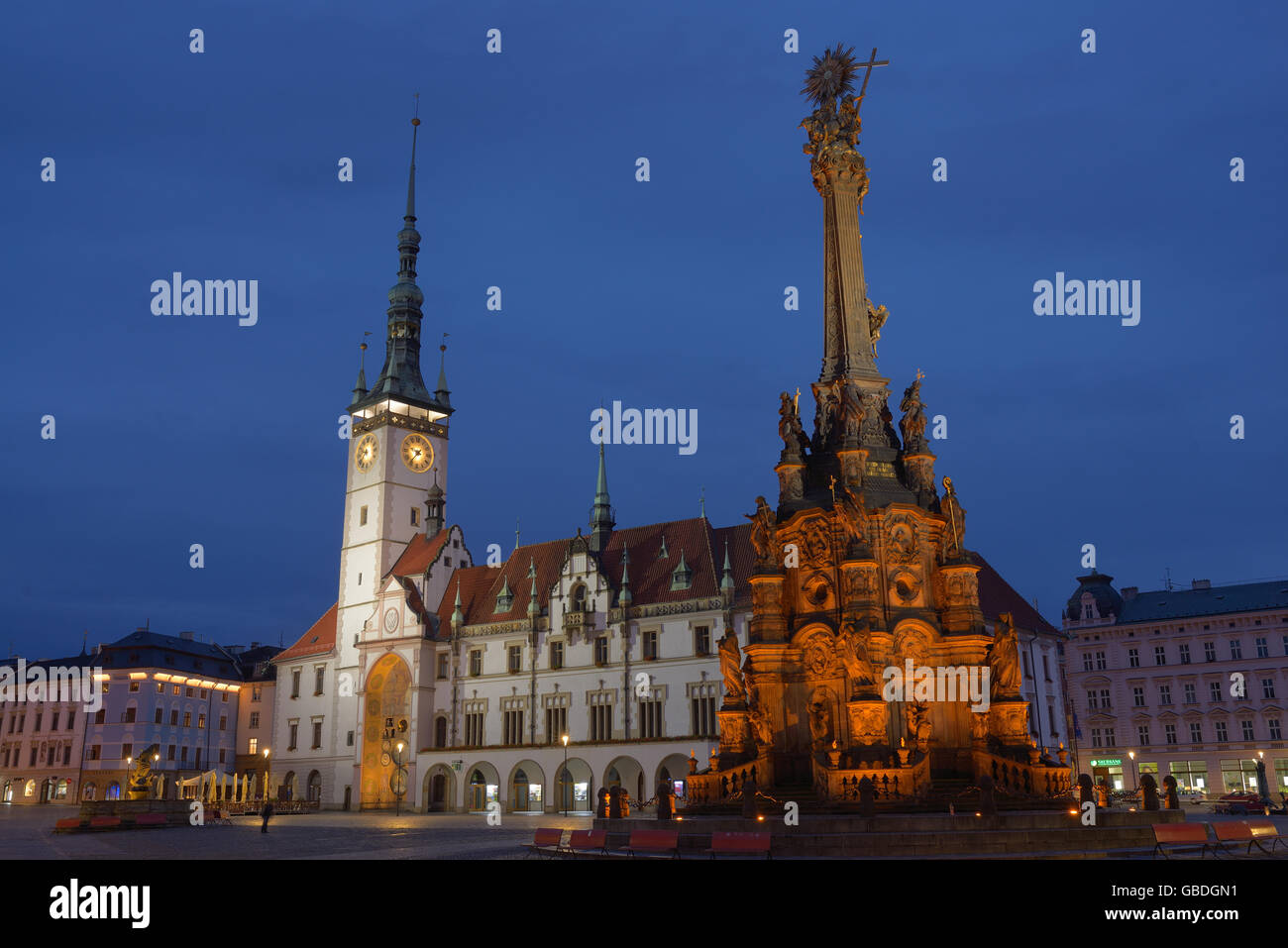 HOLY TRINITY COLUMN & TOWN HALL AT NIGHT. Olomouc, Moravia, Czech Republic. - Stock Image