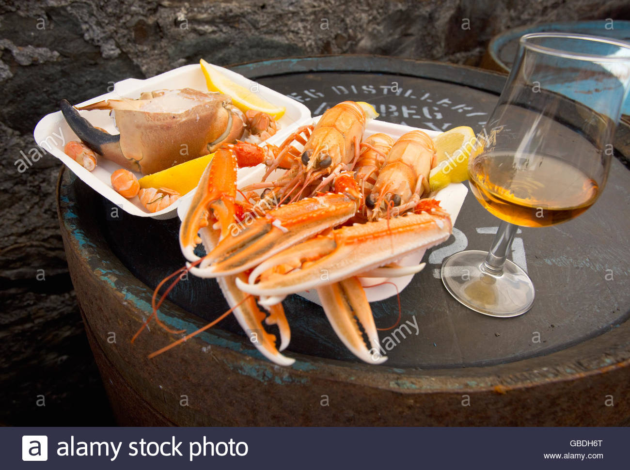 Takeaway crab and langoustines served at a distillery on the Isle of Islay, Inner Hebrides, Scotland. - Stock Image