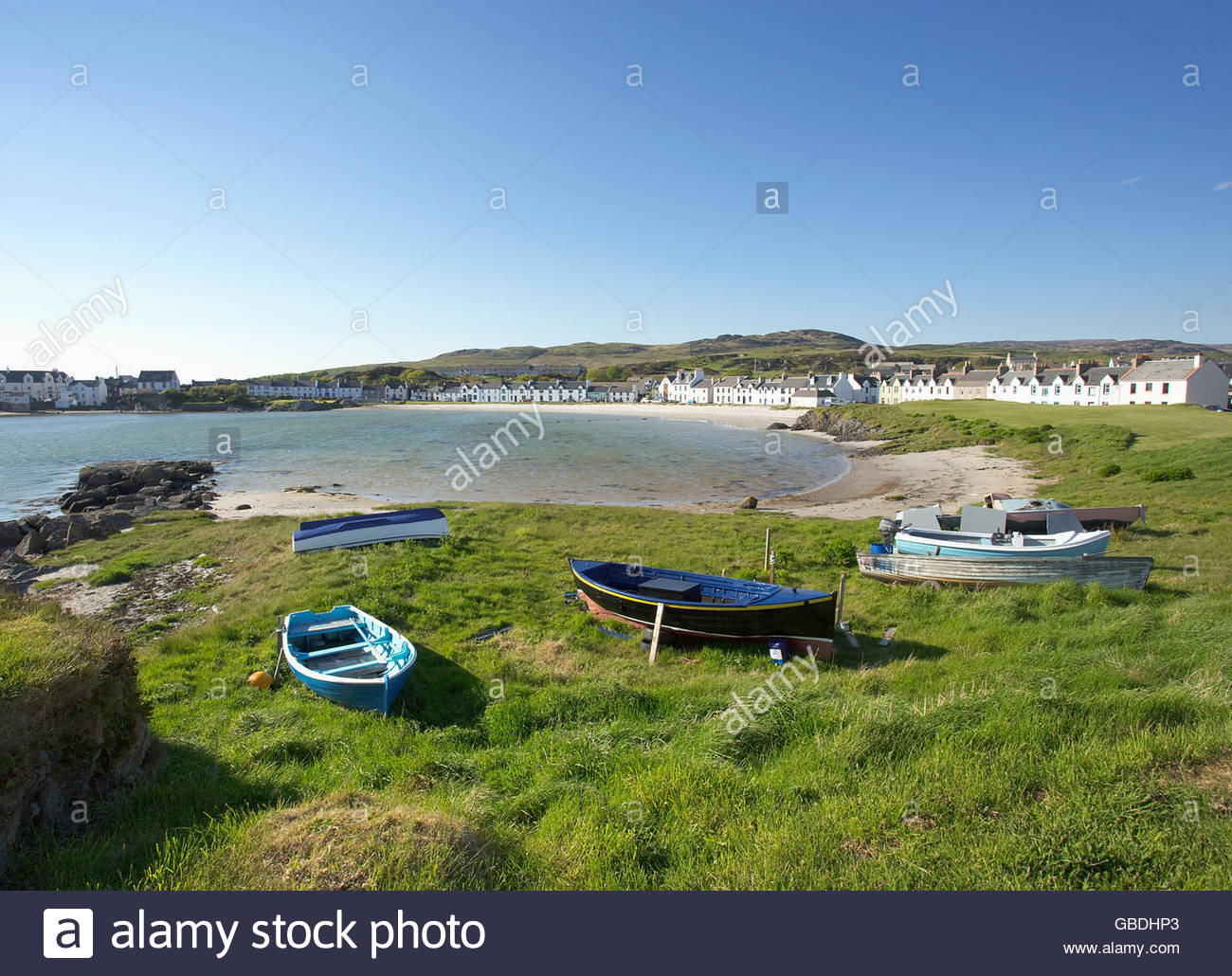 Small boats aground at Port Ellen on the Isle of Islay, Inner Hebrides, Scotland. - Stock Image
