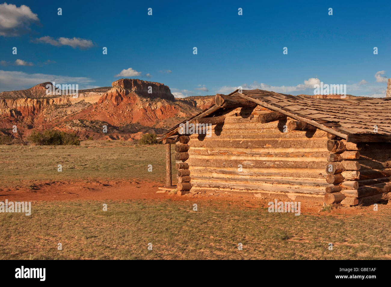 Log cabin at City Slickers movie set at Ghost Ranch near Abiquiu, New Mexico, USA - Stock Image