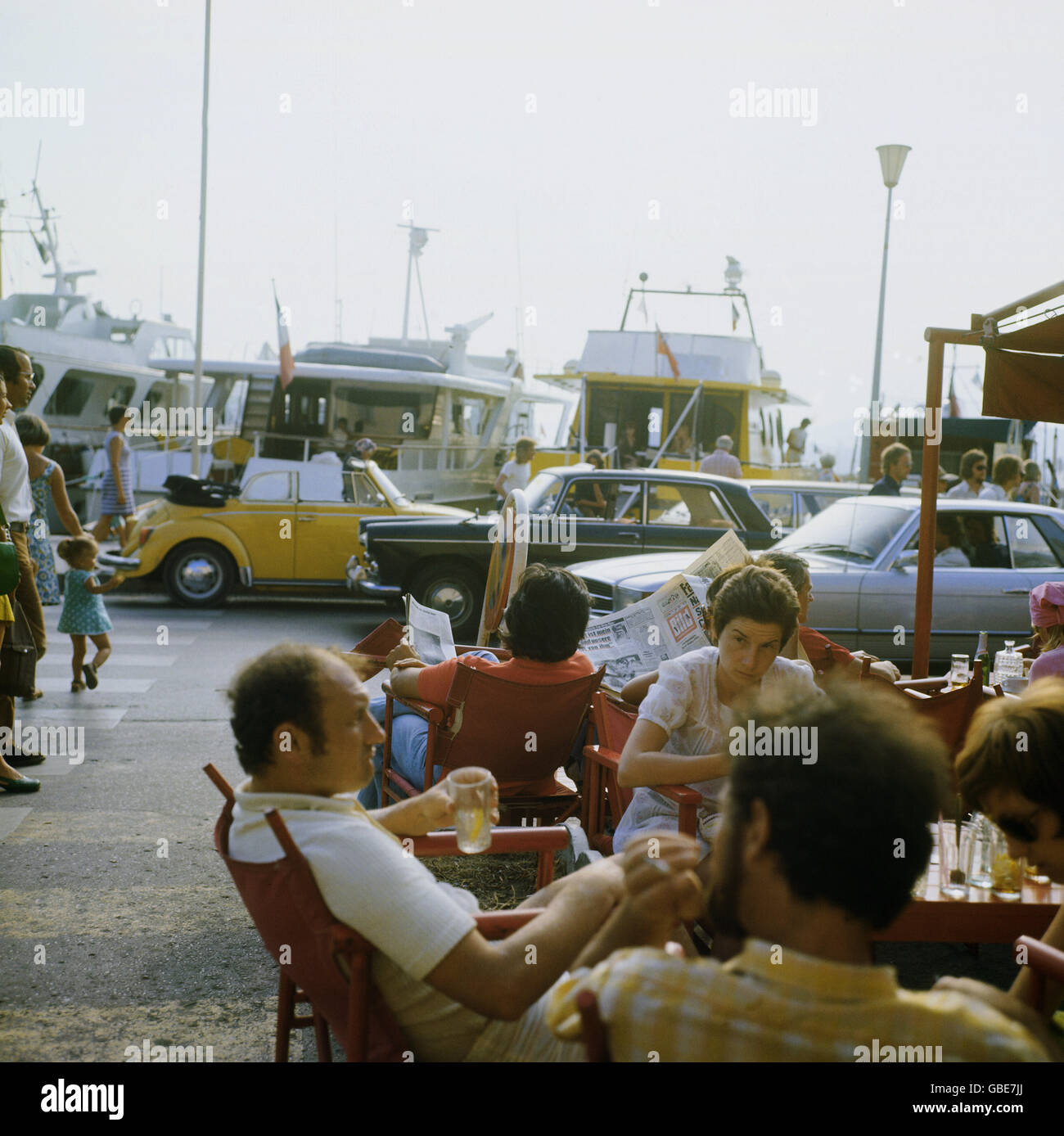 gastronomy, cafe, street cafe at harbor of St.Tropez, France, 1970s, 70s, 20th century, historic, historical, tourists, - Stock Image