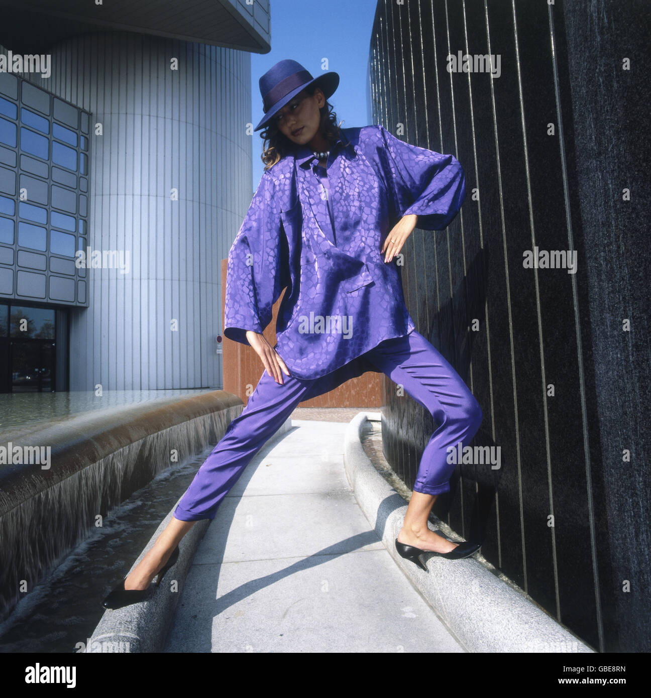 fashion, 1980s, young woman with lilac blouse, trousers and hat, location shot, Munich, Germany, Additional-Rights - Stock Image