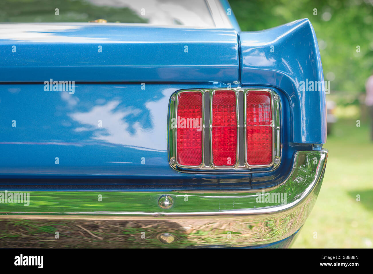 Detail Of The Rear Wing And And Tail Light Cluster Of A  Ford Mustang Coupe