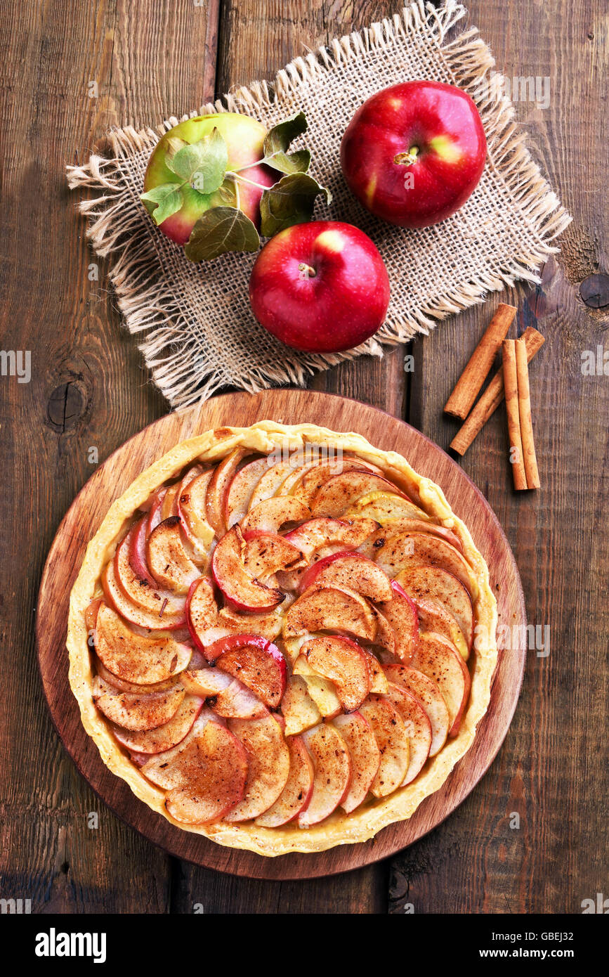 Apple pie on wooden background, top view - Stock Image