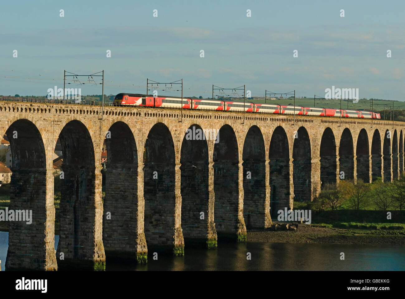 Intercity passenger train travelling over the railway viaduct built by Robert Stevenson in Berwick-upon-Tweed, England, - Stock Image