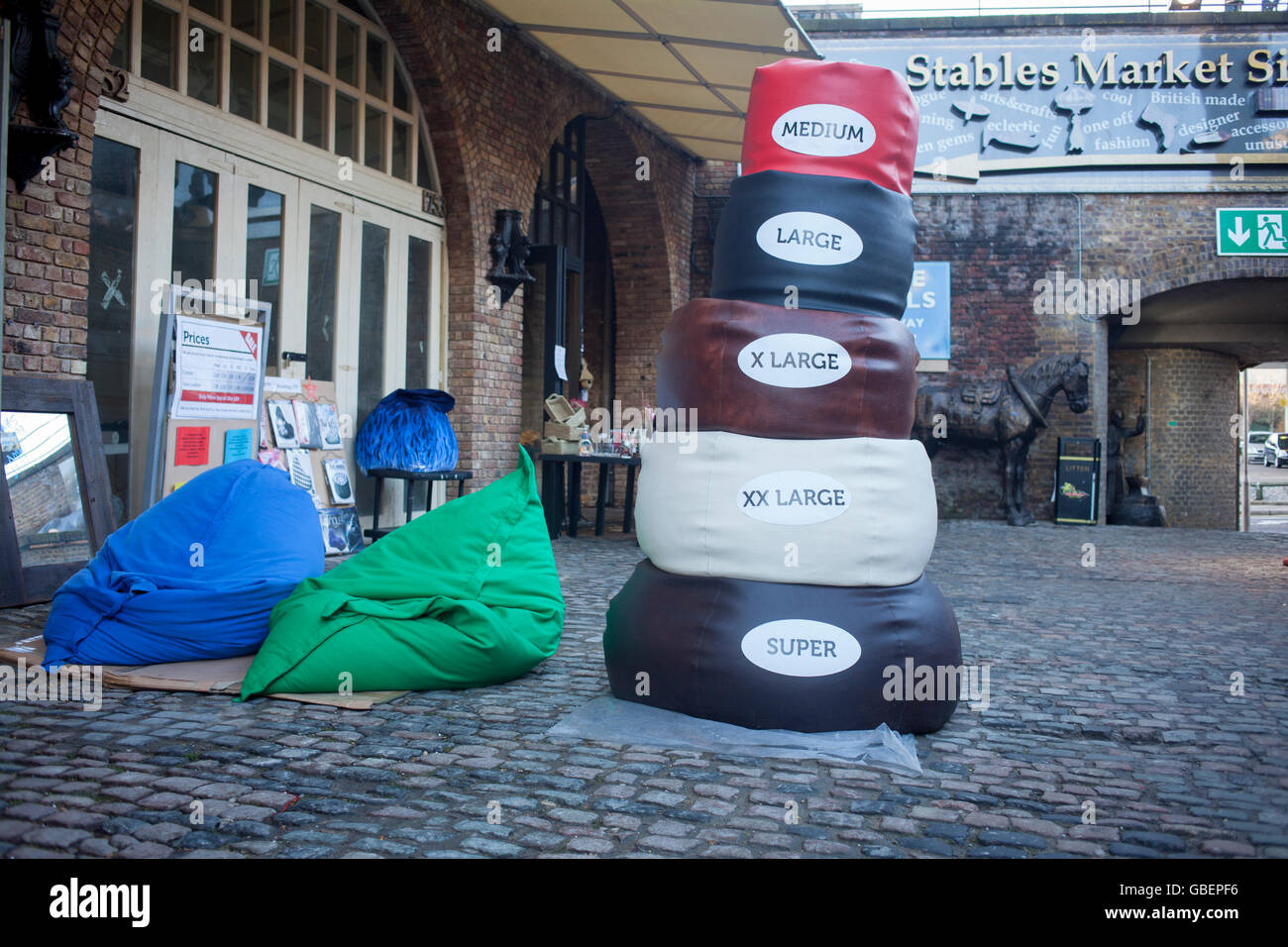 Stack of bean bags for sale in The Stables Market, Camden - Stock Image
