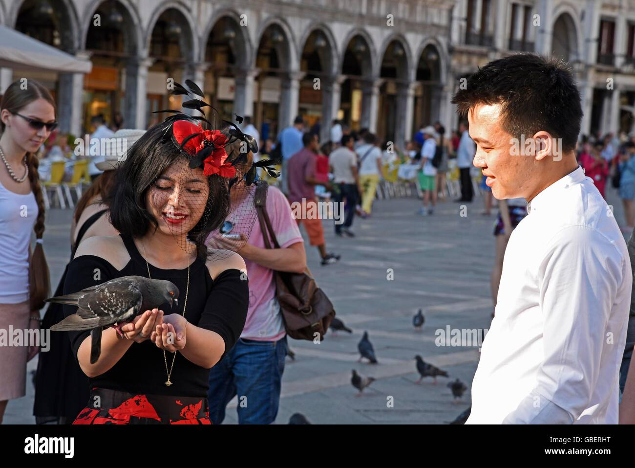 tourists, doves, feed, feeding, Piazza di San Marco, San Marco Stock ...