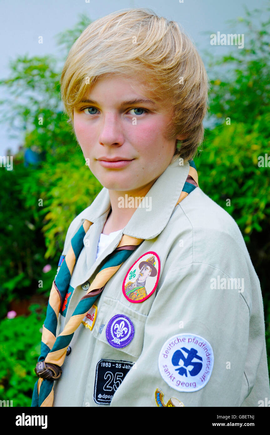 Boy, 13 years, shirt, scarf, gear, badges, Boy Scout, Germany - Stock Image