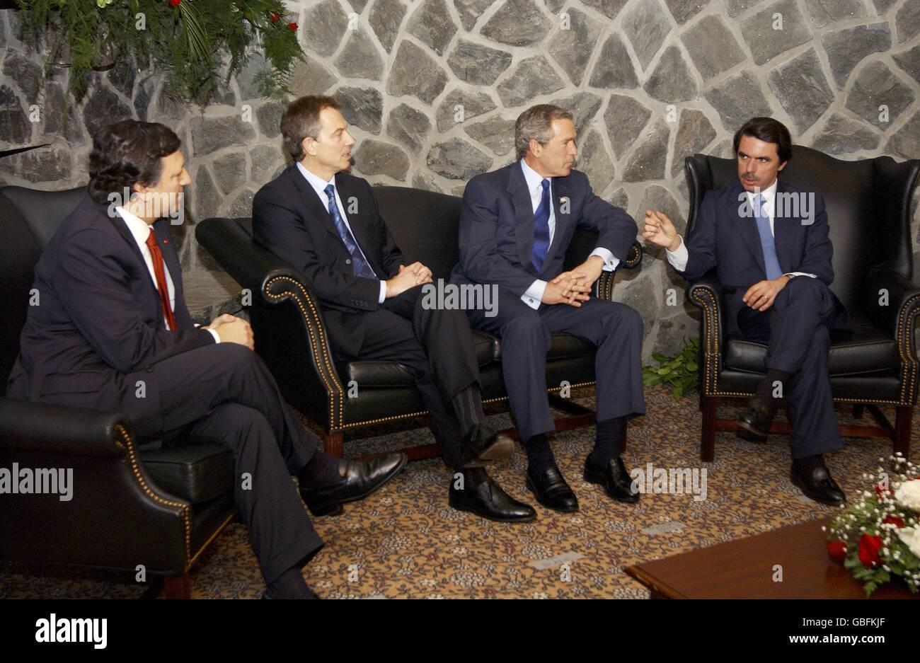 U.S. President George W. Bush listens to Spanish Prime Minister Jose Maria Aznar, right, as British Prime Minister - Stock Image