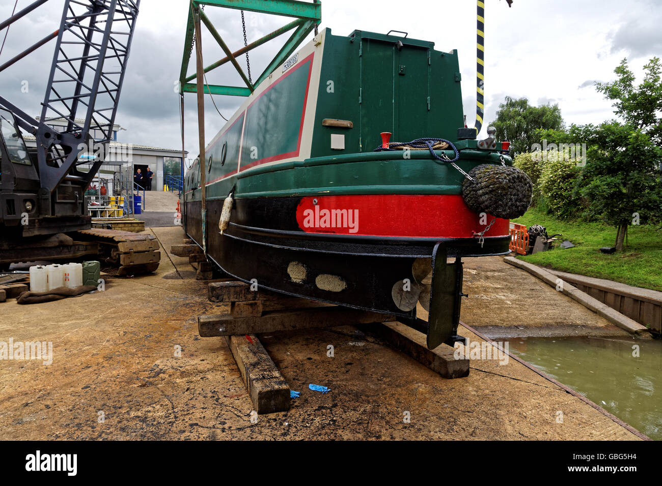 narrowboat out of the water  on slipway for blackening - Stock Image