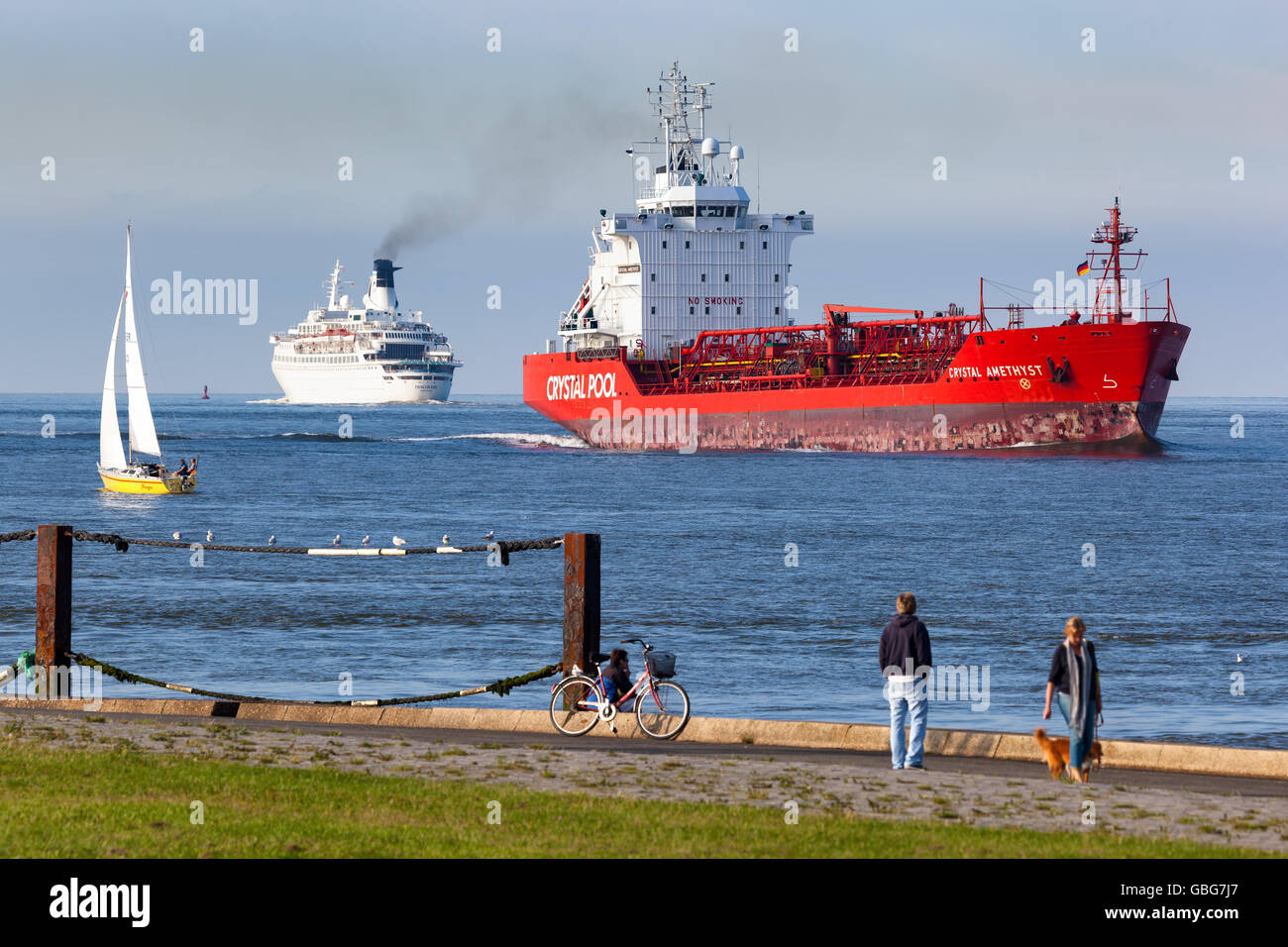 Evening scene at Cuxhaven, Germany with Oil/Chemical Tanker 'CRYSTAL AMETHYST' and Cruise Ship 'DISCOVERY'. - Stock Image
