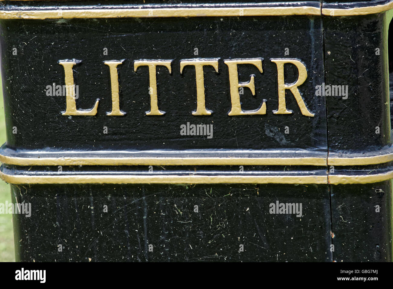 black  cast-iron litter bin with gold lettering - Stock Image