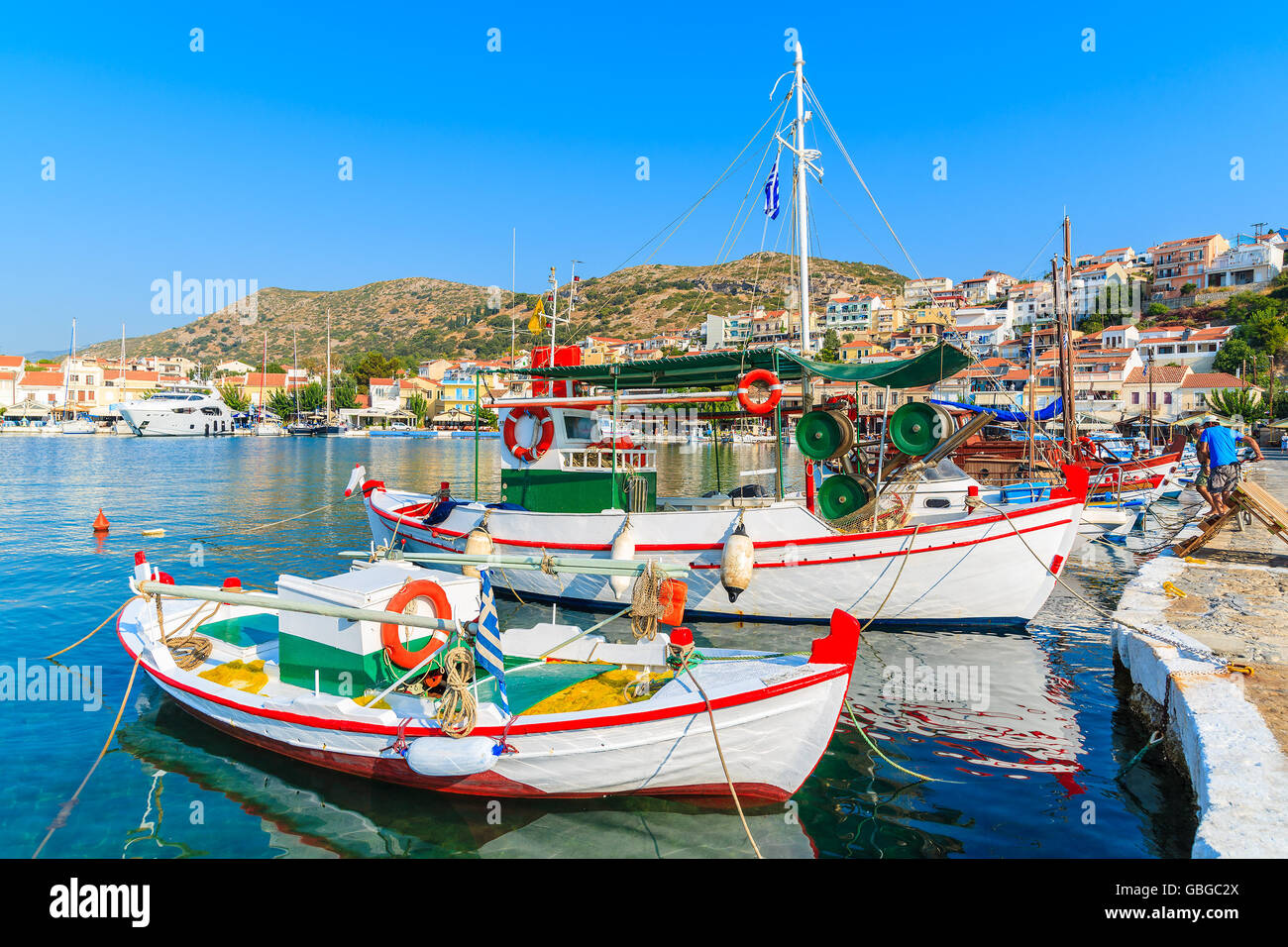 Typical colorful Greek fishing boats in Pythagorion port on Samos island, Greece Stock Photo