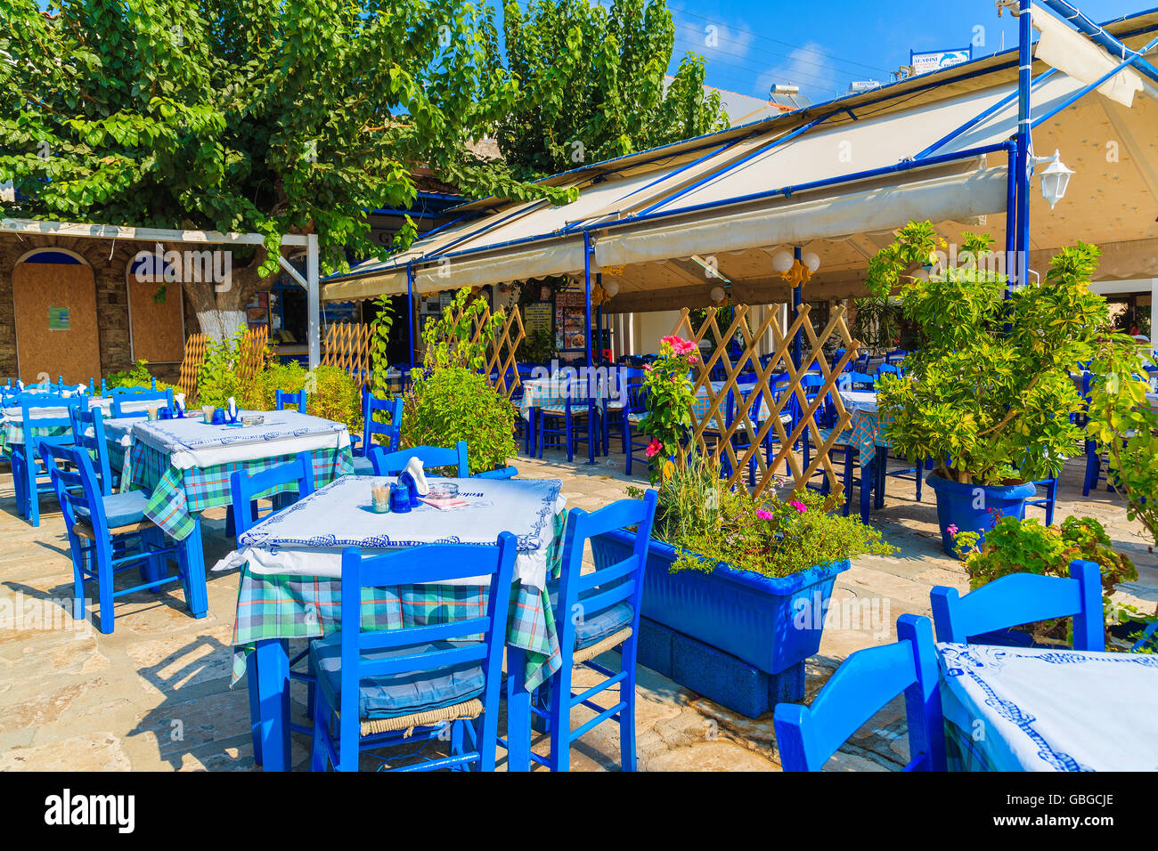 pythagorion port samos island sep 19 2015 blue chairs with tables in