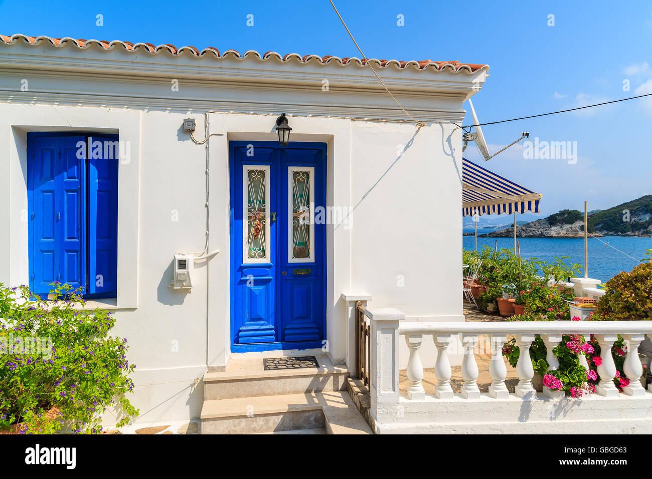 blue door house. Typical White Greek House With Blue Door And Window In Kokkari Town On Coast Of Samos Island, Greece A