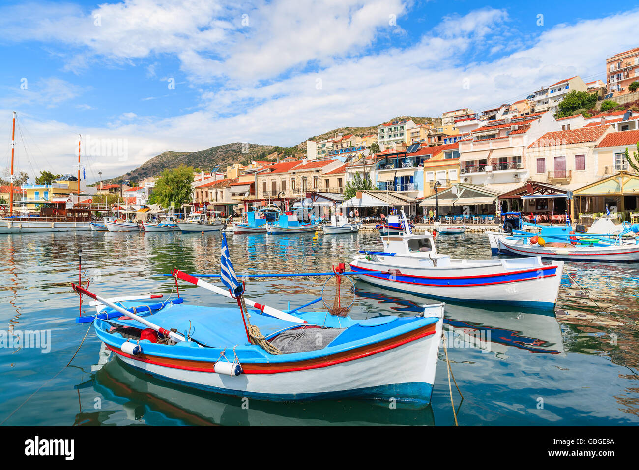 Traditional colourful Greek fishing boats in Pythagorion port, Samos island, Greece Stock Photo