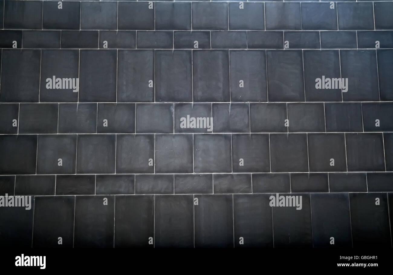 Background of the black brick wall, photo - Stock Image
