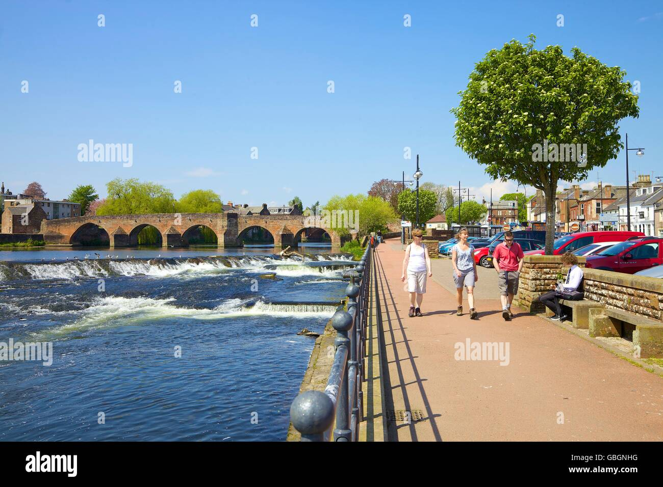 Tourists walking along river embankment. River Nith, White Sands, Dumfries, Dumfries & Galloway, Scotland, United - Stock Image