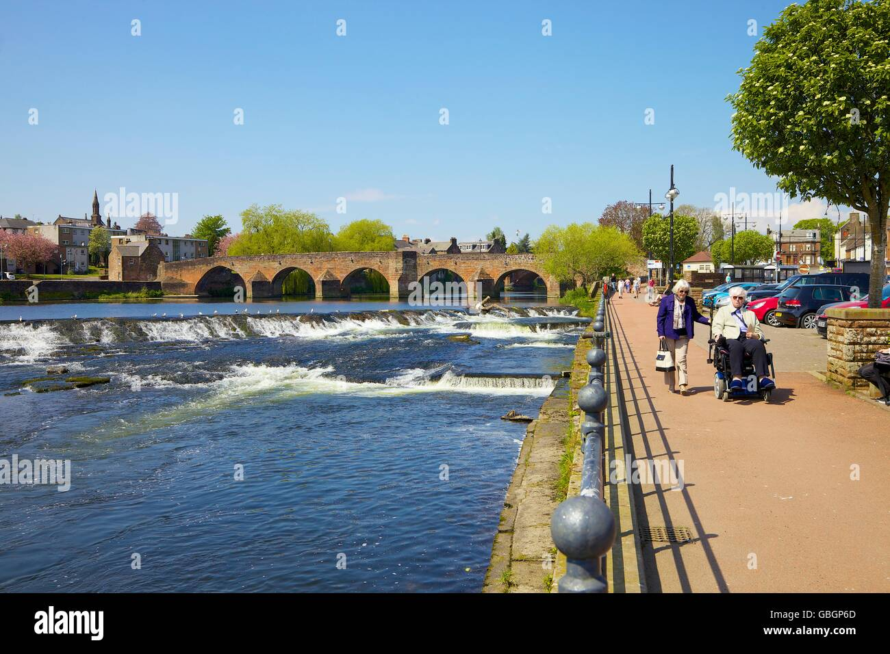 People on river embankment. River Nith, White Sands, Dumfries, Dumfries & Galloway, Scotland, United Kingdom, - Stock Image