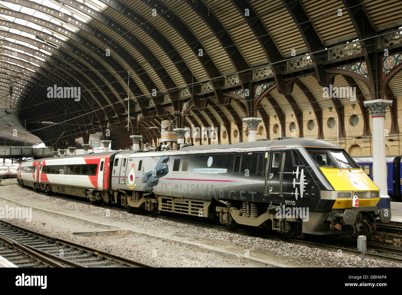 Class 91 loco 91110 'Battle of Britain Memorial Flight' in commemorative livery at York station, UK with - Stock Image
