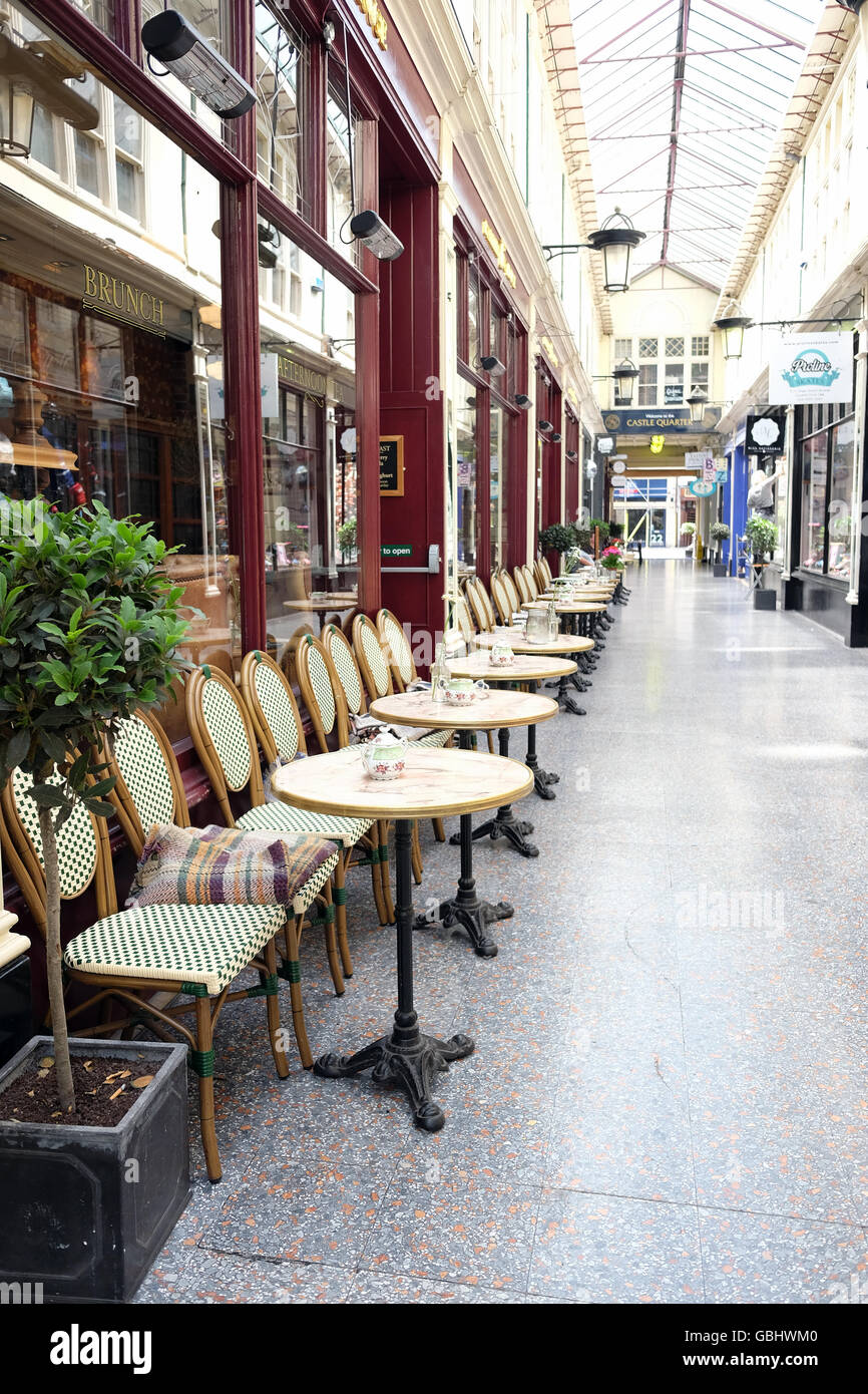 Line of café chairs in Cardiff Castle Quarter arcade July 2016 & Line of café chairs in Cardiff Castle Quarter arcade July 2016 Stock ...