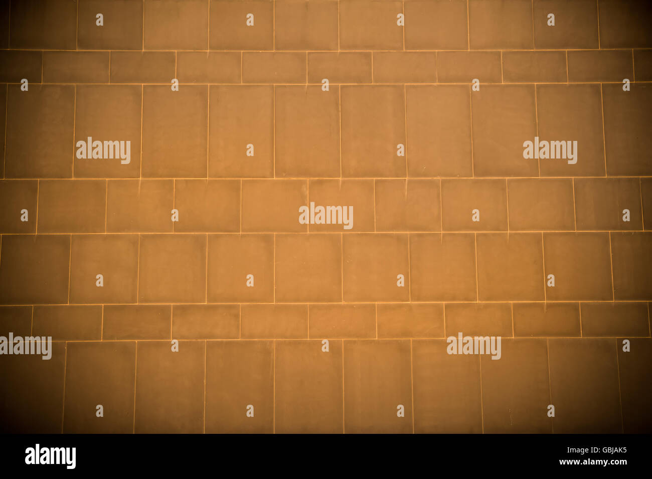 Background of the yellow brick wall, photo - Stock Image