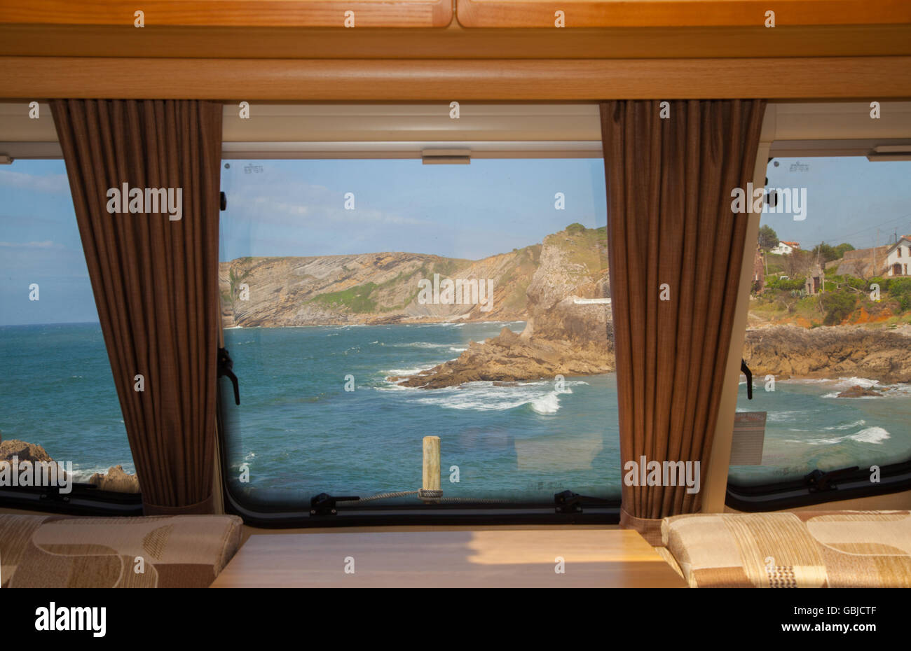 View from a caravan window of the sea and cliffs in Comillas Cantabria Northern Spain Stock Photo