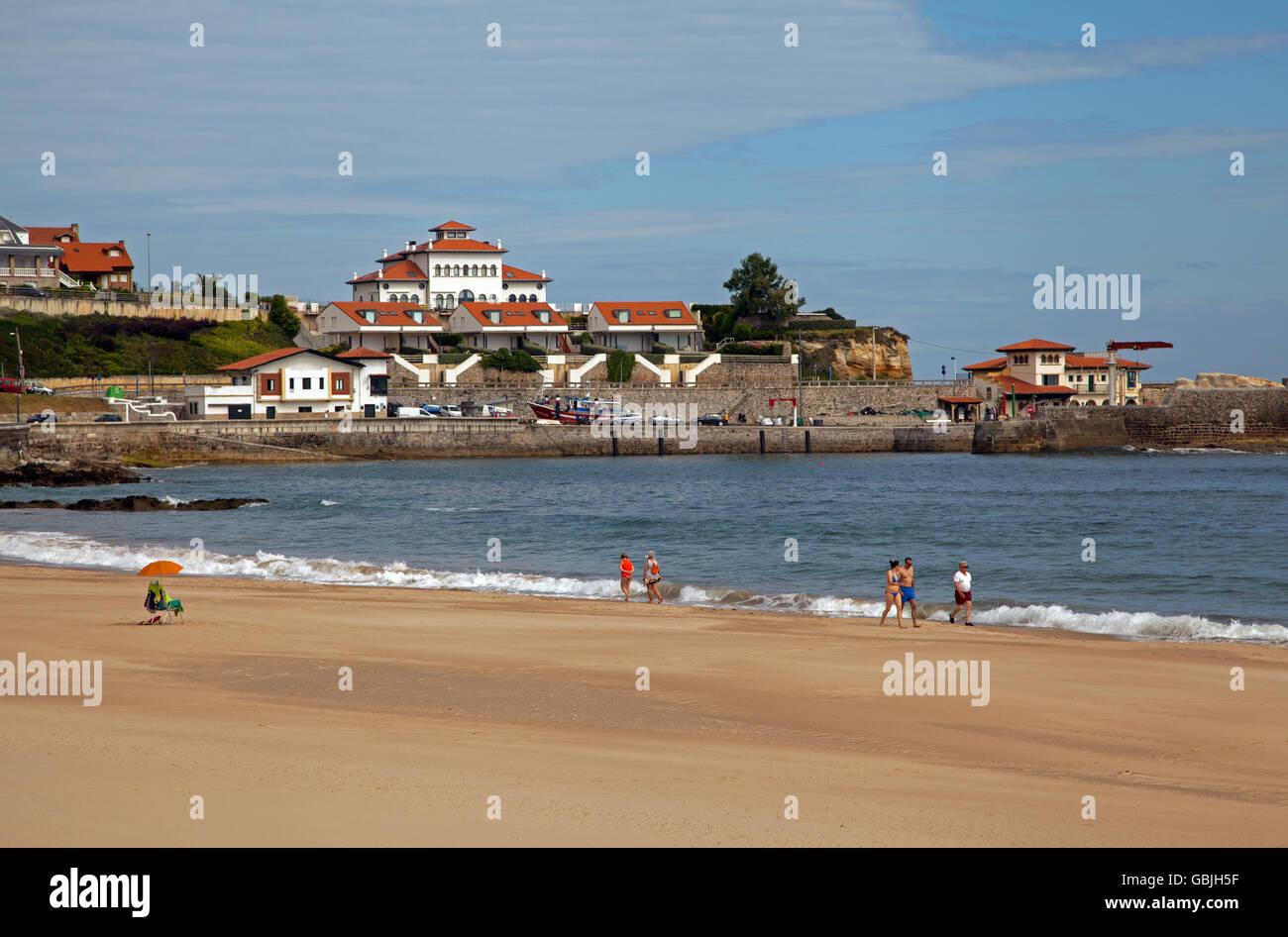 View of the beach and harbour at the seaside resort of comillas Northern Spain - Stock Image