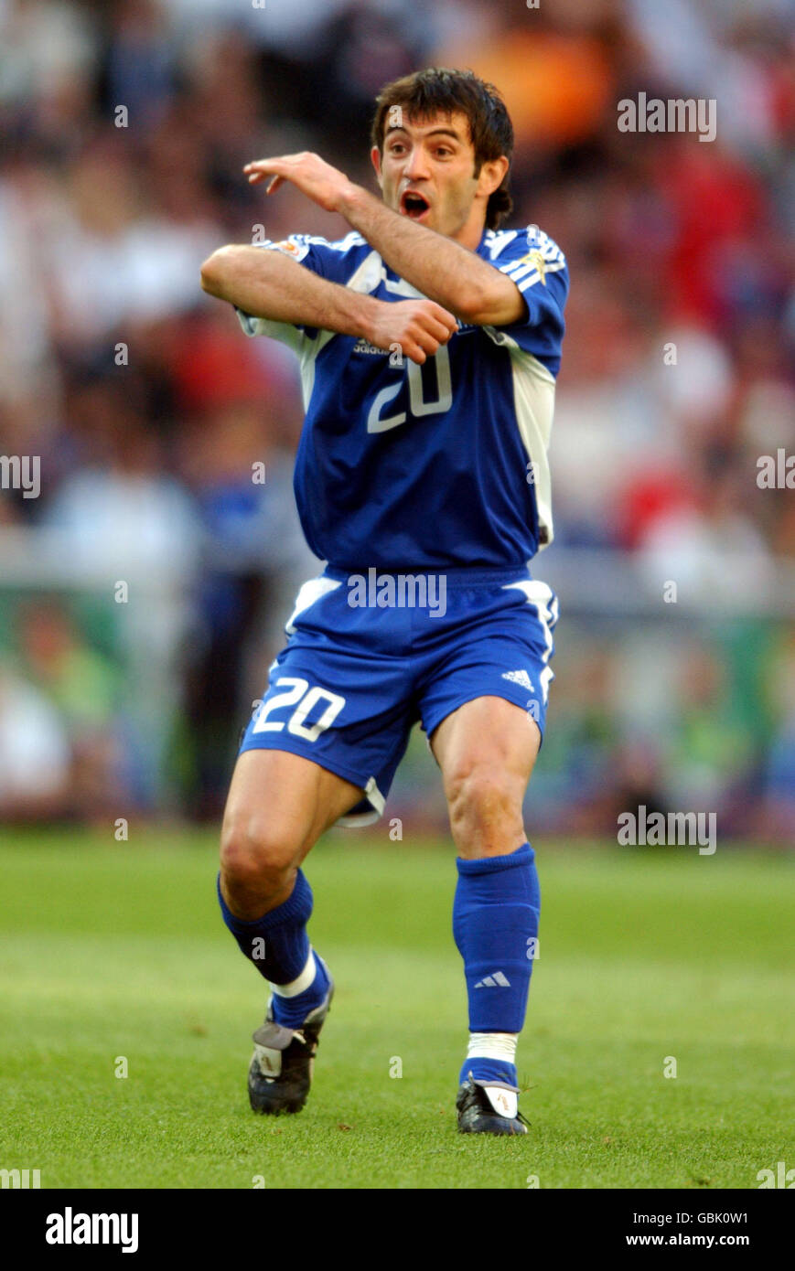 Greece's Georgios Karagounis appeals against a yellow card as he misses the final Stock Photo